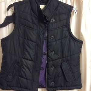 Lack somewhat puffy vest. Never worn.  Too tight.